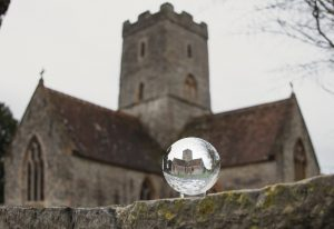Lens ball in front of a church